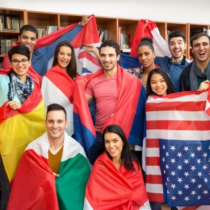 International multiethnic exchange of students, happy students presenting their countries with flags
